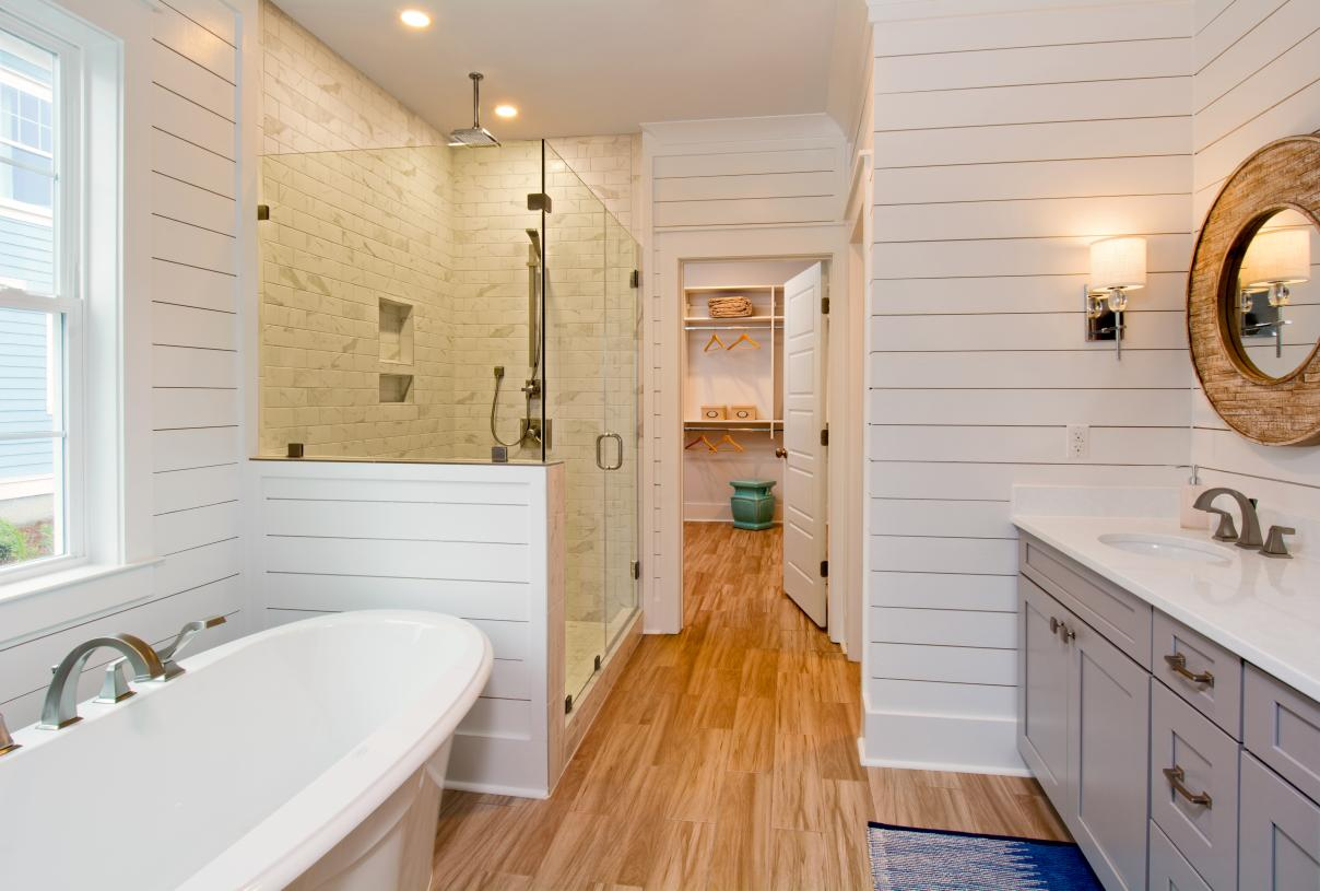 Lavish primary bathroom with large walk-in shower and soaking tub