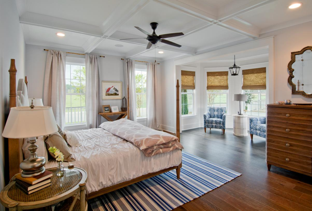Spacious primary bedroom suites with a large seating area