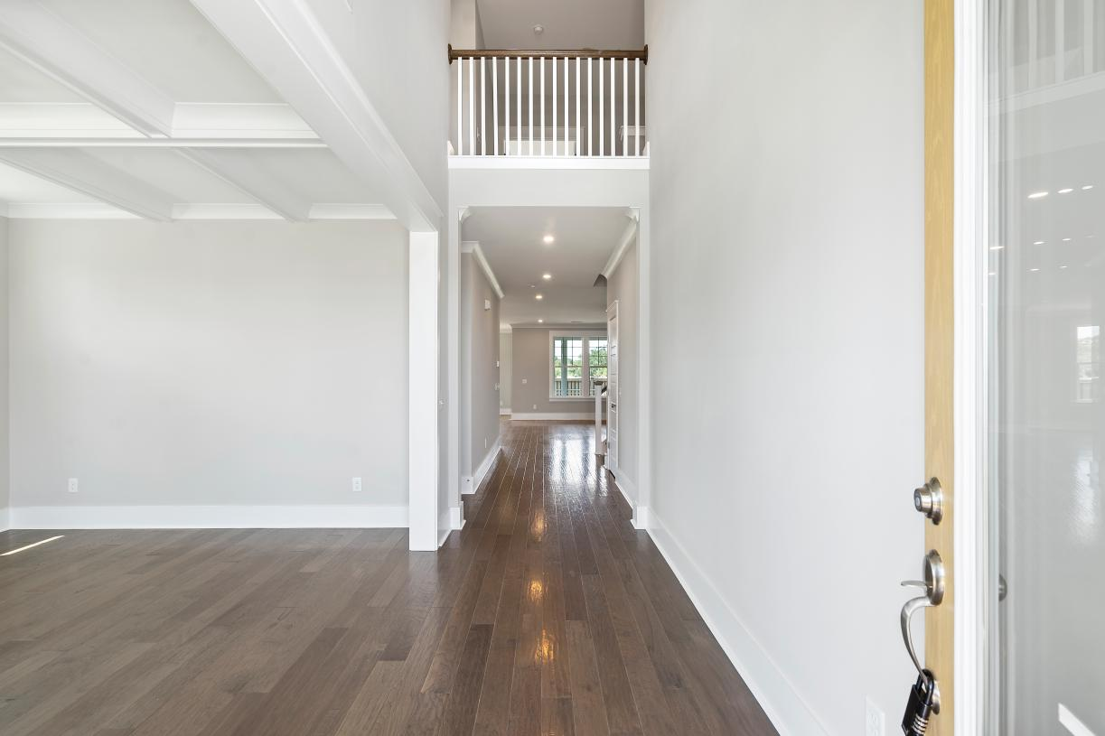 Soaring two-story ceilings offer a grand entrance