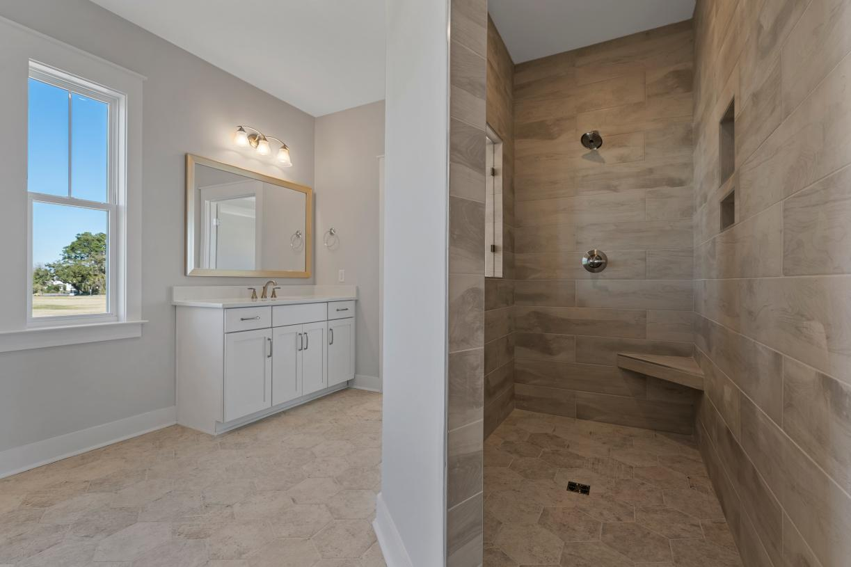Lavish primary bathrooms with optional cave showers and dual split vanities