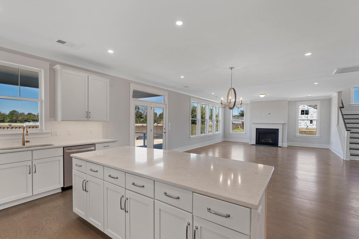 Open concept floor plans with views of the great room and covered porch beyond