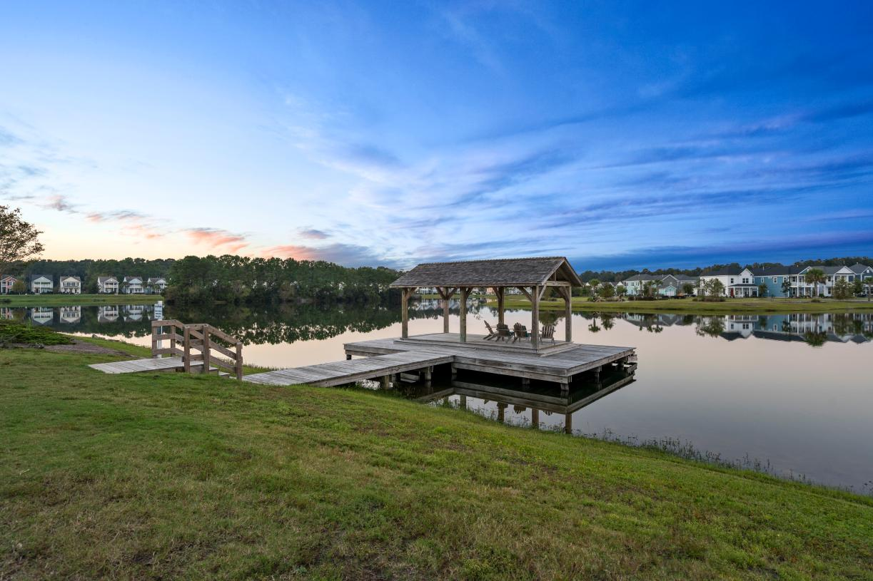 Community lake with a dock for outdoor relaxation