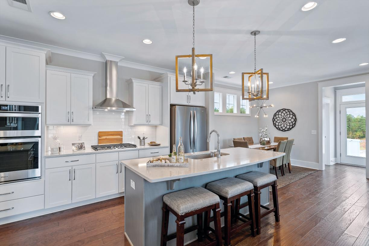 Luxurious kitchen with breakfast bar and adjacent casual dining space