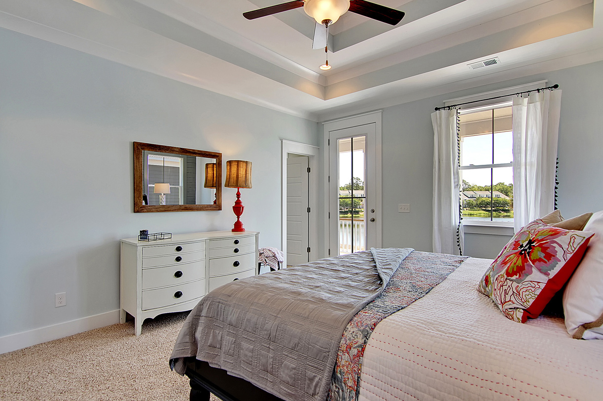 Large primary bedroom suites with access to second floor covered deck