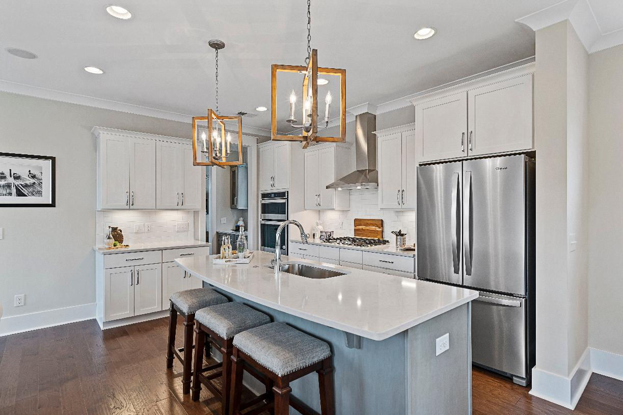 Beautiful kitchen with breakfast bar and stainless steel appliances