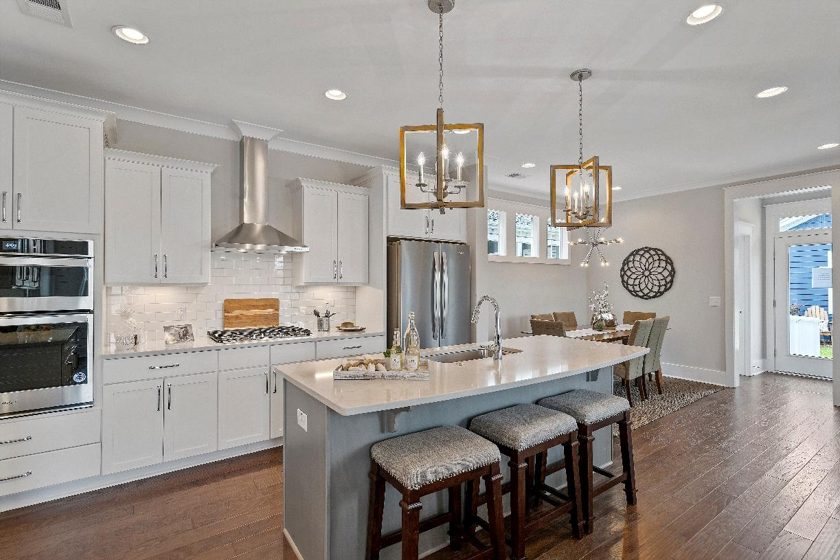 Kitchen with ample storage and counter space and adjacent casual dining area
