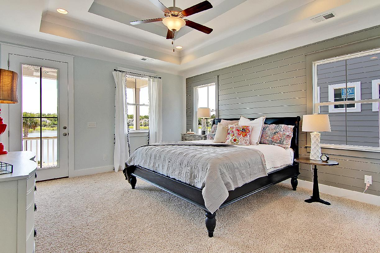 Spacious primary bedroom with access to balcony
