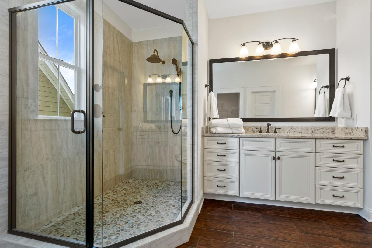 Lavish primary bathrooms with luxe-glass enclosed showers