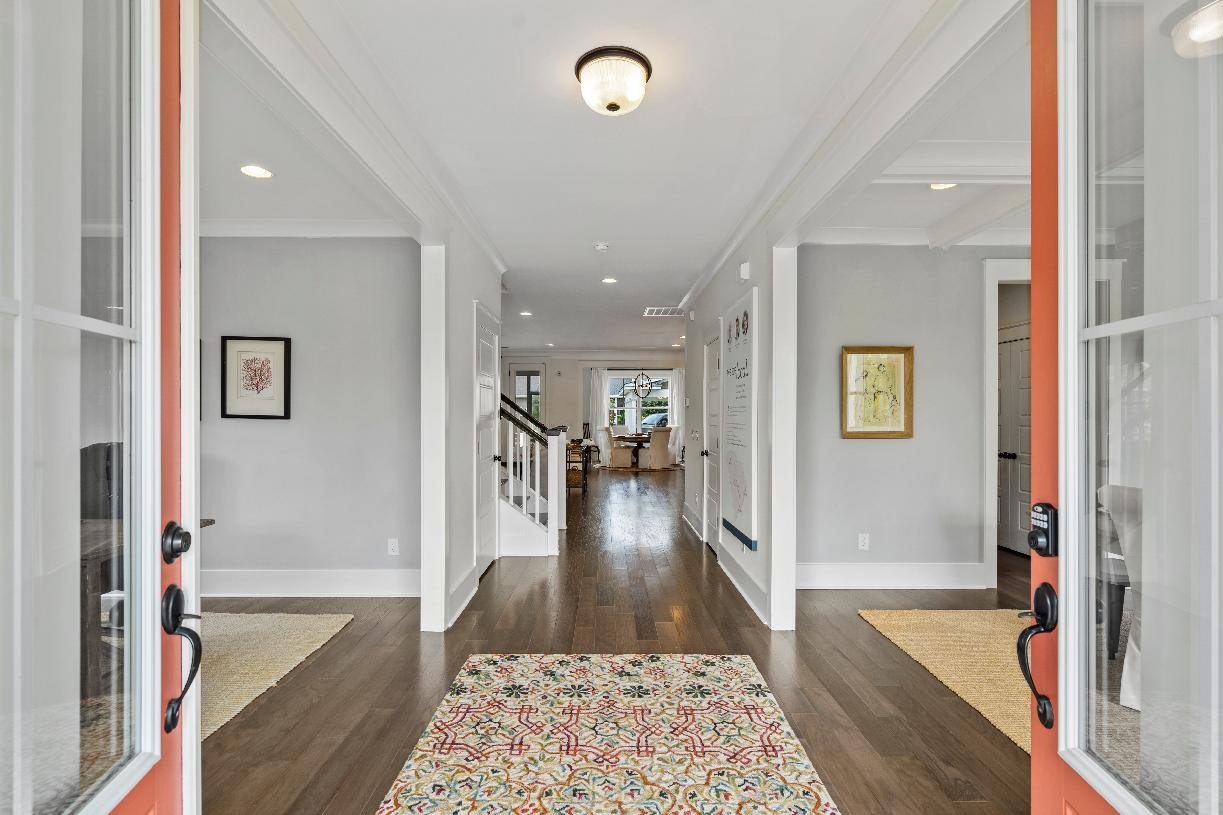 Wide foyers with views of the open concept floor plan beyond