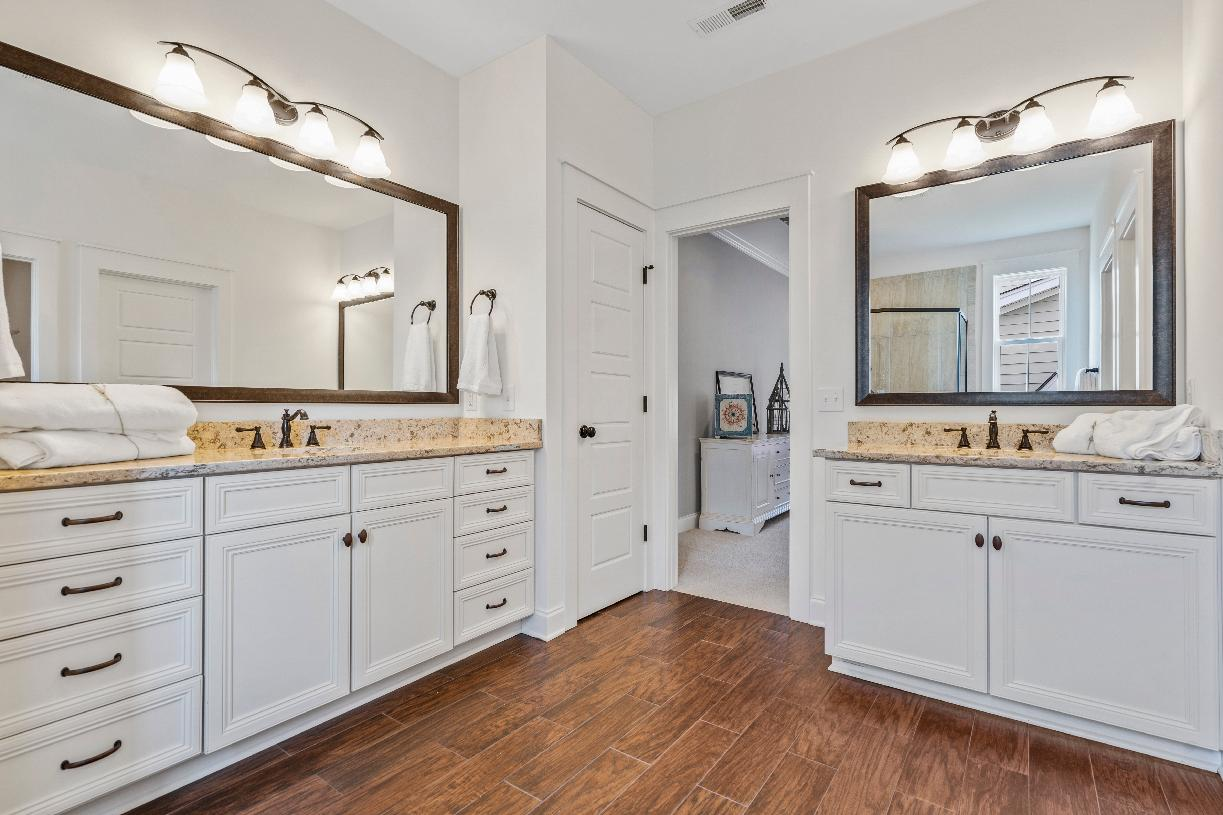 Lavish primary bathrooms with dual split vanities