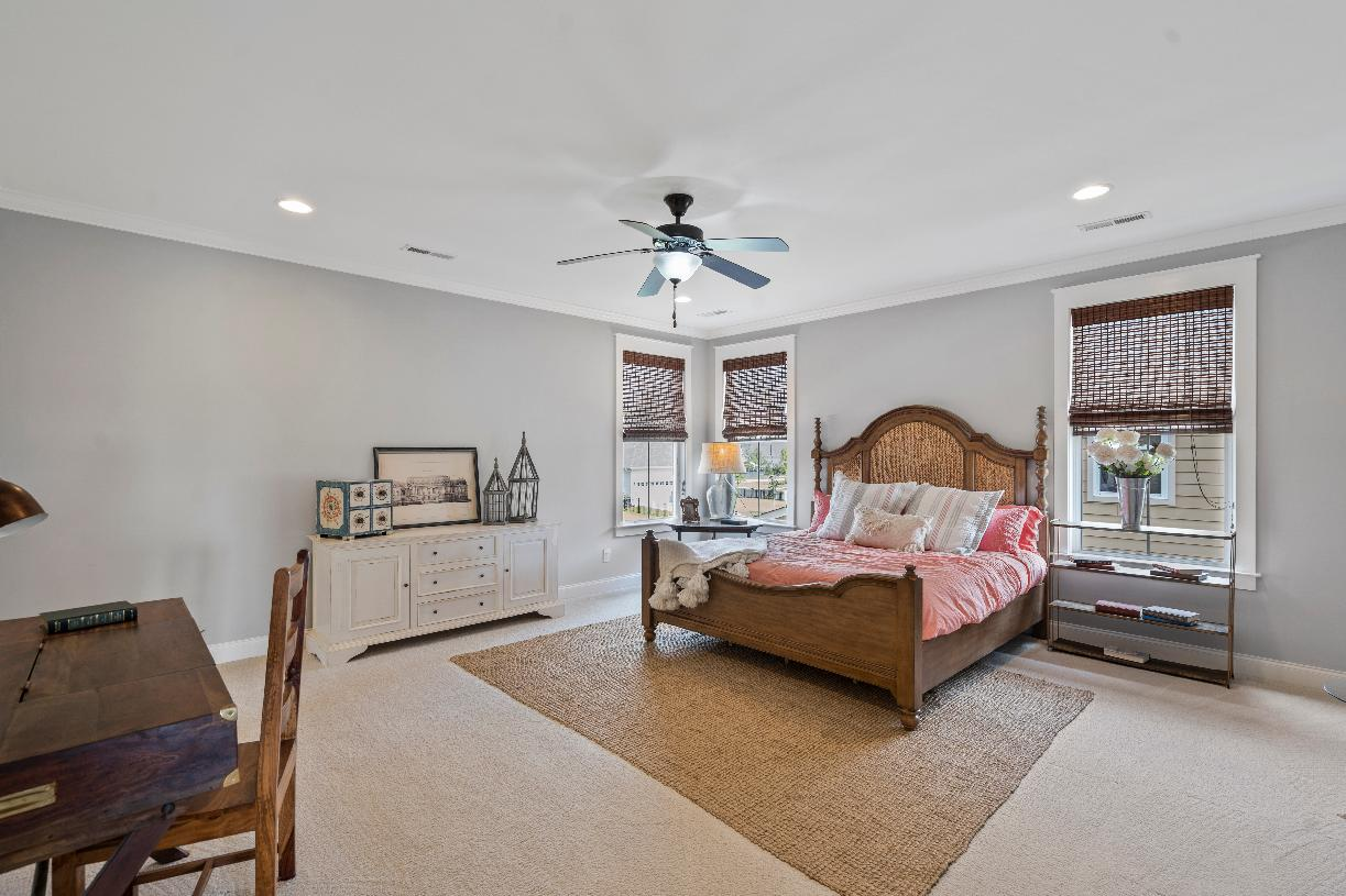 Spacious primary bedroom suites with seating areas