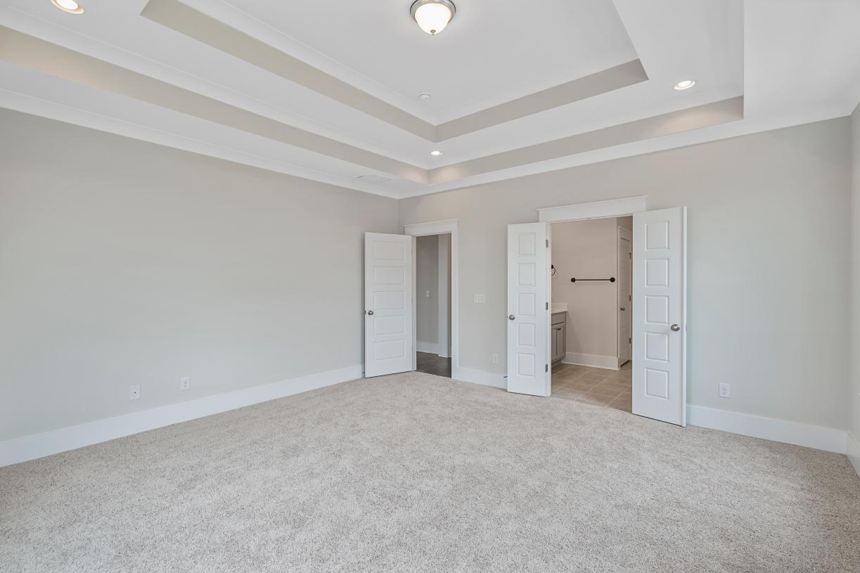 Spacious primary bedroom suites with beautiful ceilings