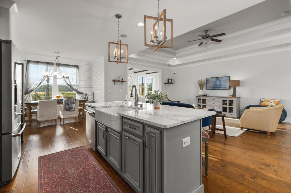 Open concept floor plan with large center island and views of the great room beyond
