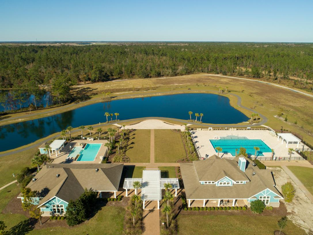 Aerial view of community amenities and walking paths around the community lakes