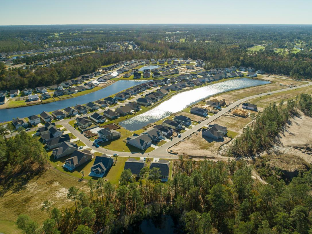 Community aerial with ponds and surround by trees