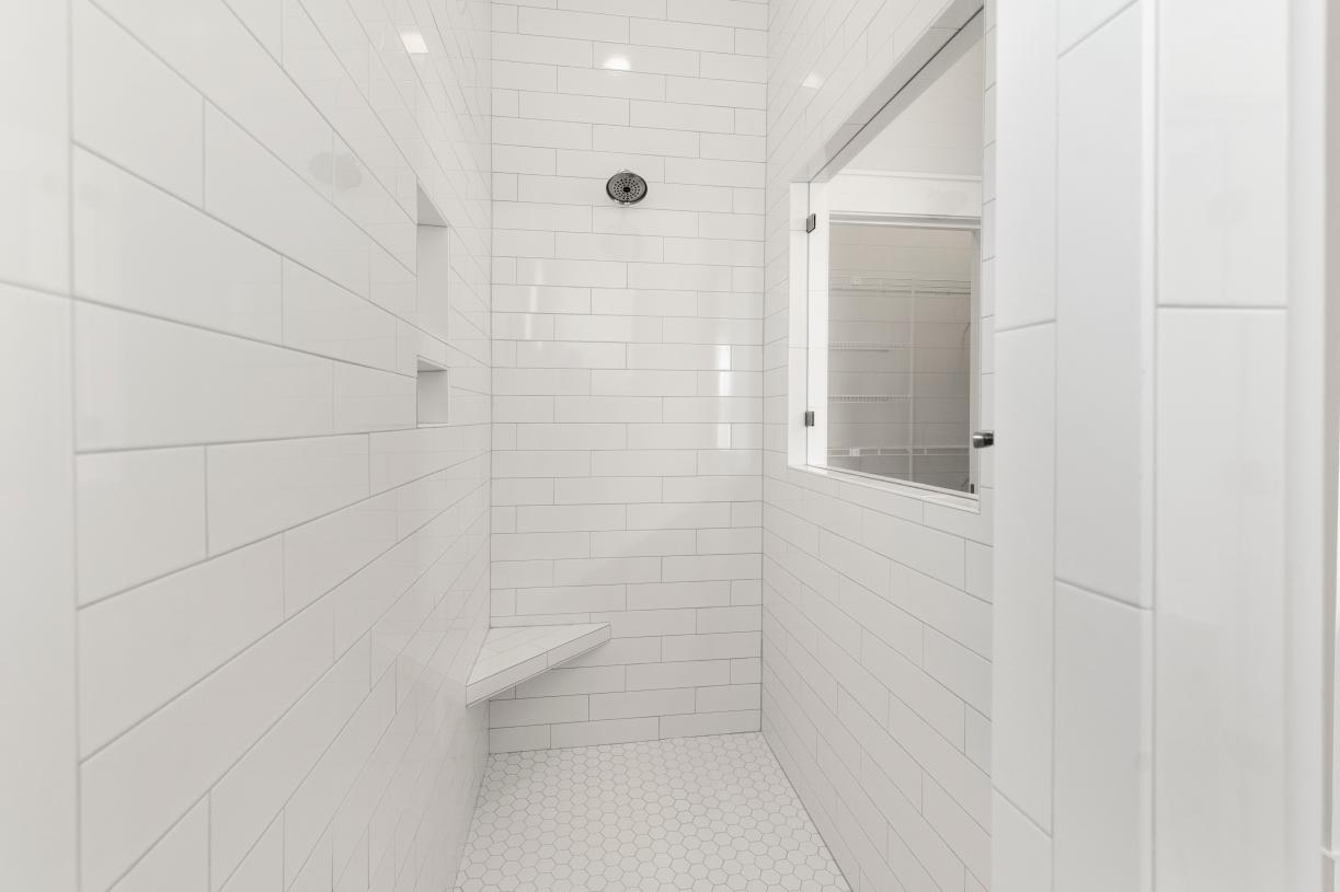Optional cave showers in the primary bathroom