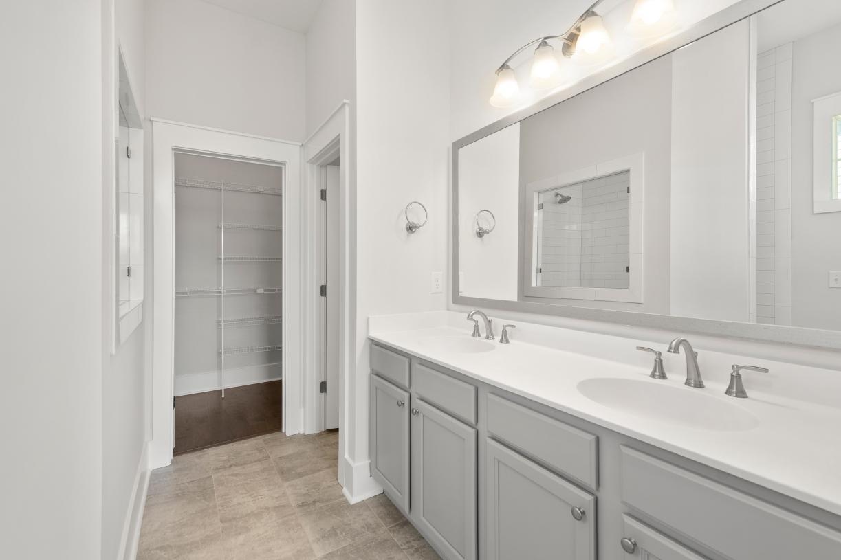 Lavish primary bathrooms with walk-in closets