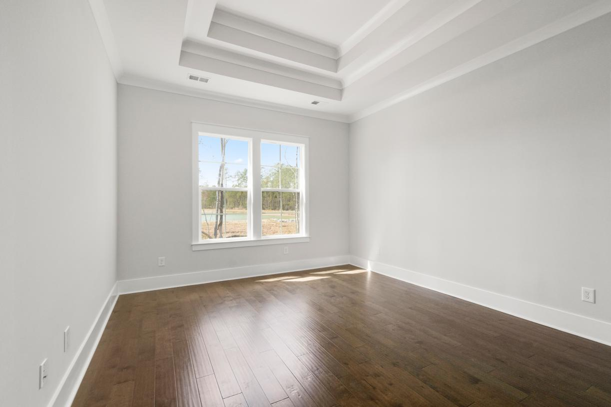 Spacious primary bedroom suites with beautiful ceiling options