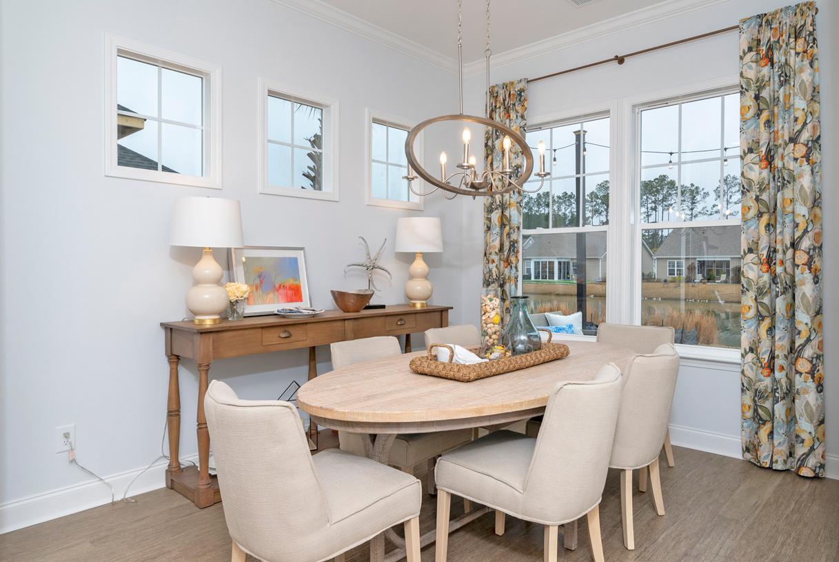 Casual dining areas adjacent to the kitchen with ample natural light