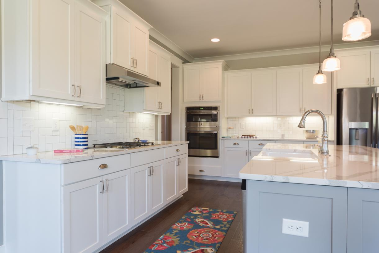 Luxurious kitchens with ample cabinet space and upgraded appliances