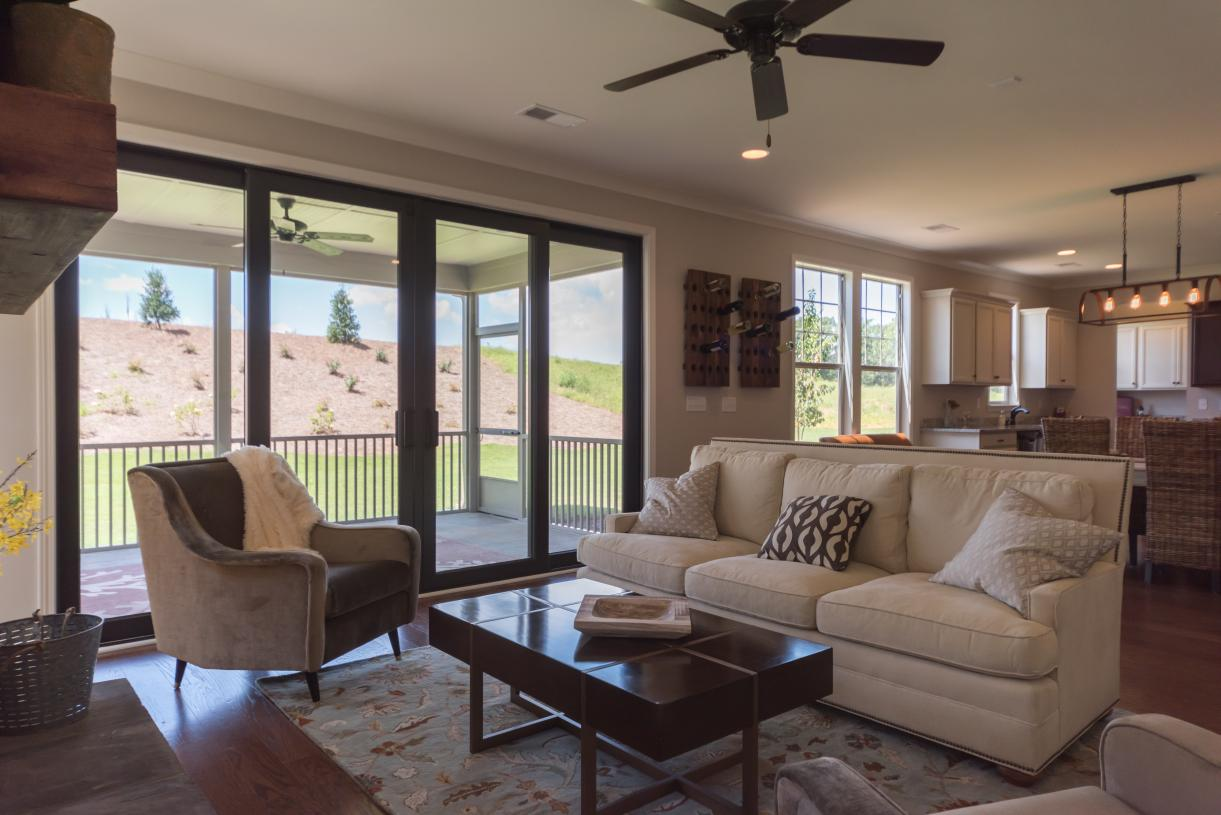 Open concept great room with sliding doors to bring the outside in