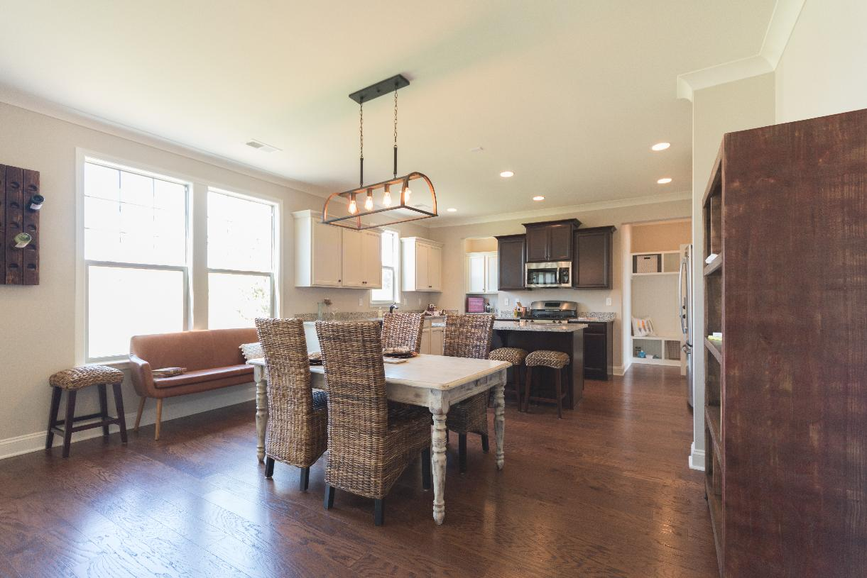 Open-concept floor plan with casual dining area adjacent to kitchen
