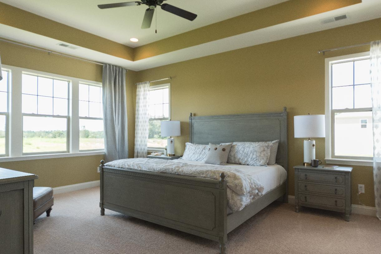 Spacious primary bedroom suite with ample natural light