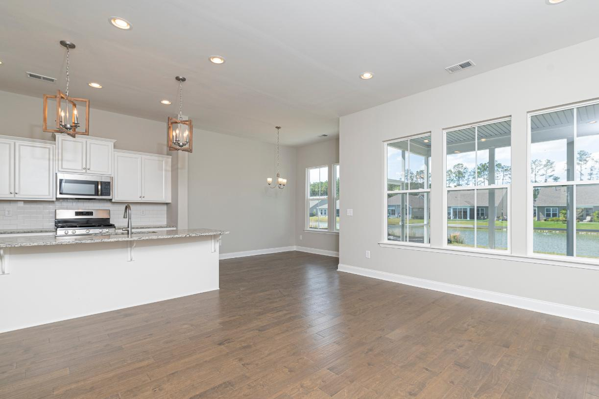 Open concept floor plans with casual dining areas adjacent to the kitchen