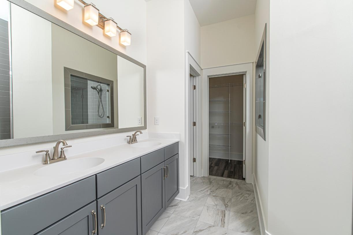Lavish primary bathrooms with optional cave showers