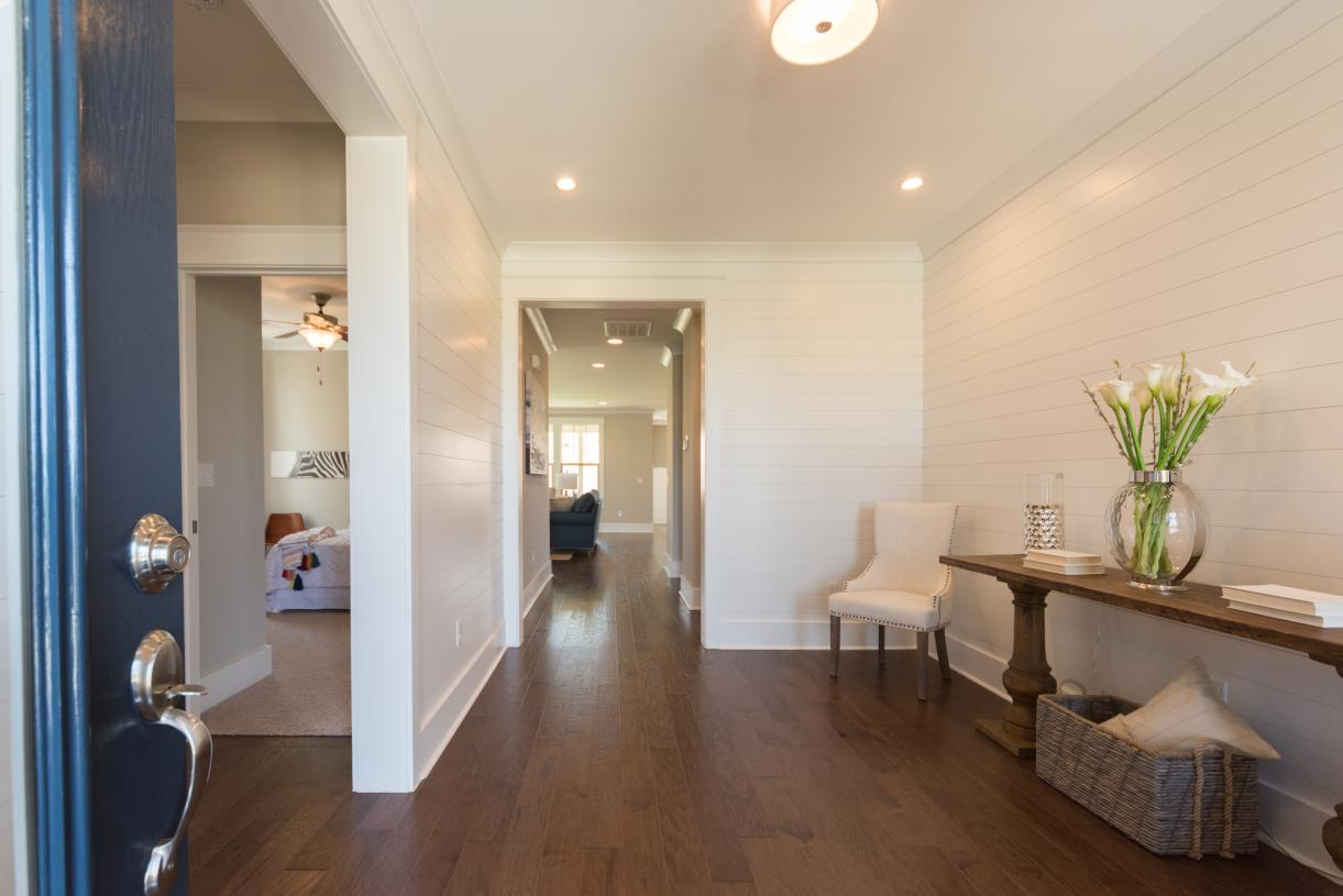 Spacious foyer with views of luxury appointments and the great room beyond