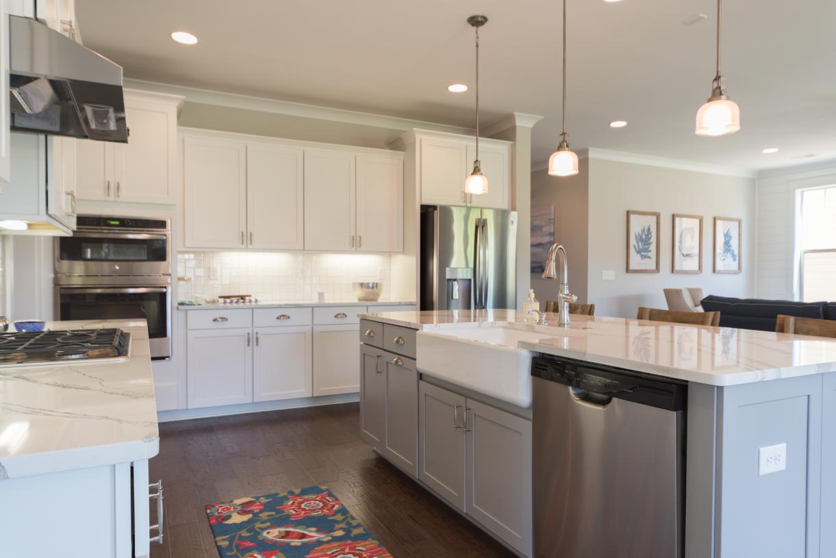 Kitchens with large center islands and views of the great room beyond