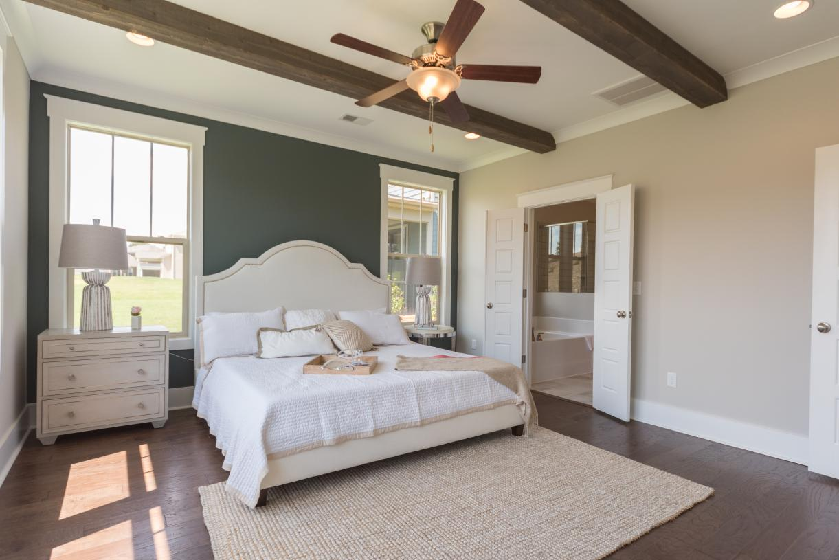 Spacious primary bedroom suites with gorgeous ceilings