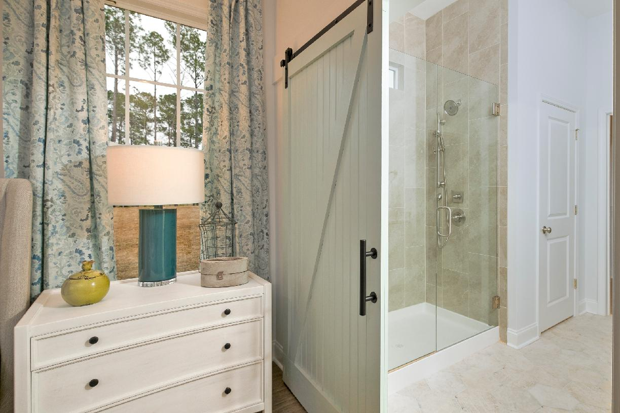 Primary bathrooms with large walk-in showers
