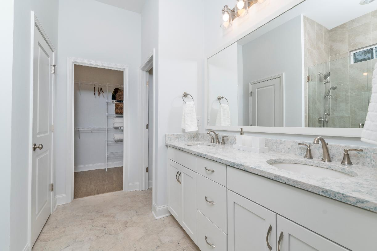Lavish primary bathrooms with walk-in closets and private water closets