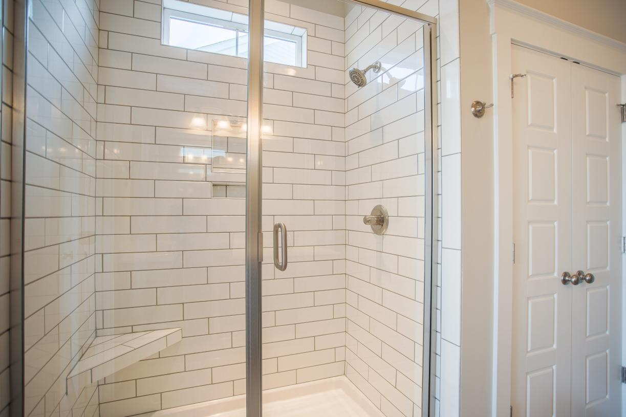 Beautiful primary bathrooms with tiled walk-in showers