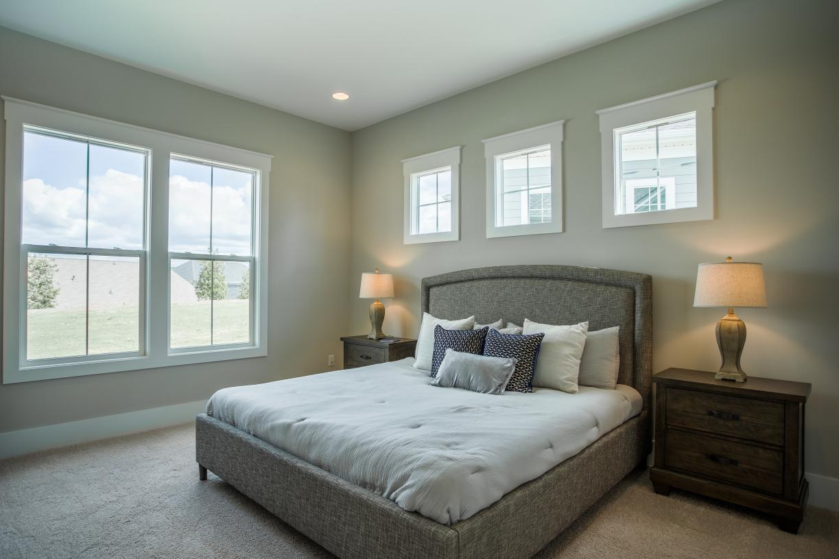 Spacious primary bedroom suites with ample natural light