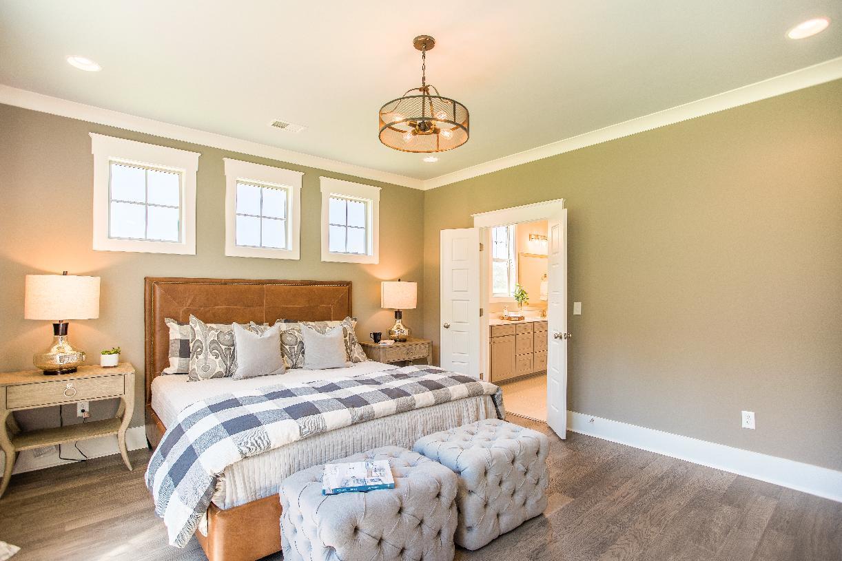 Spacious primary bedroom suites with lavish primary bathrooms