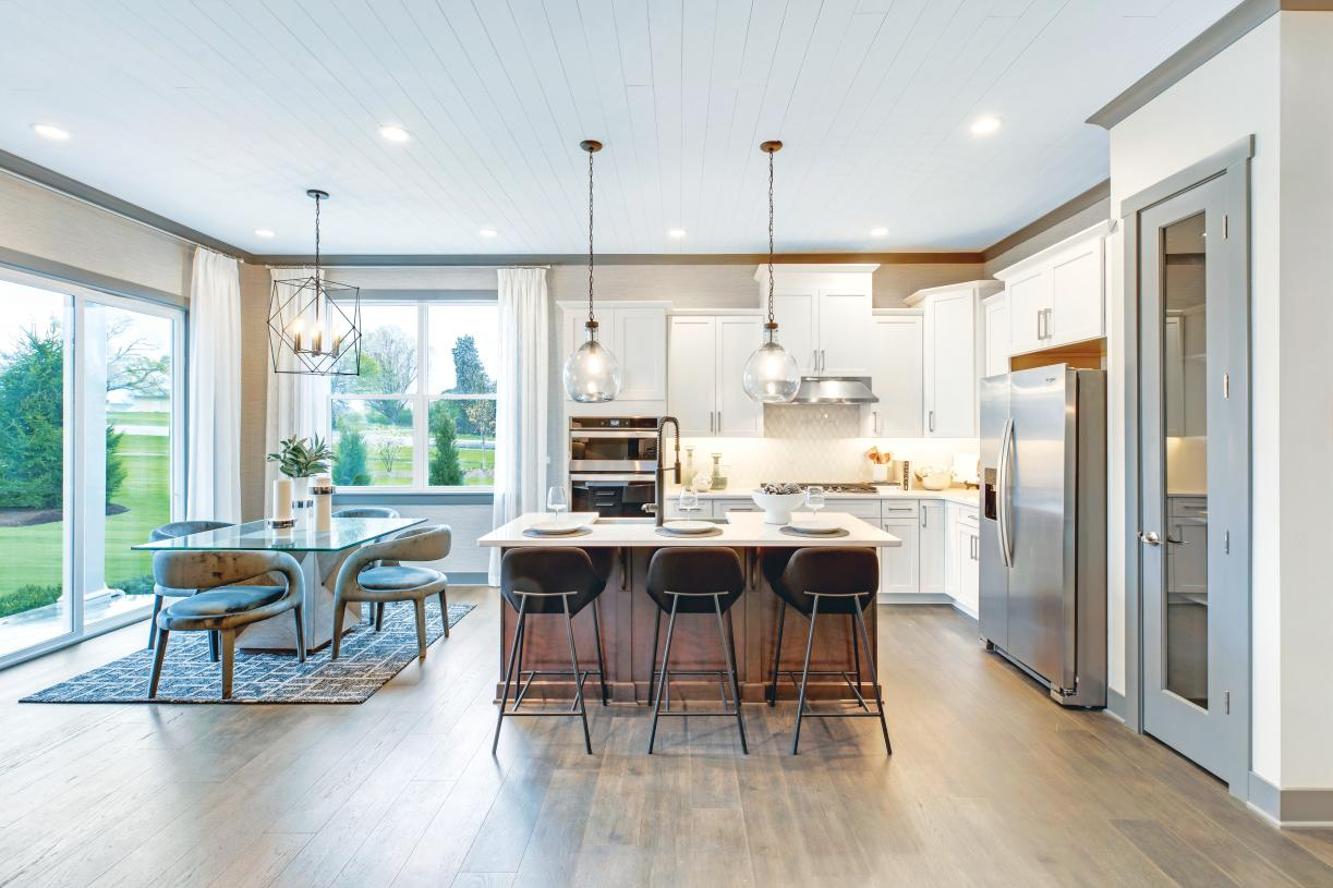 Standard gourmet kitchen with large center island open to casual dining area and great room