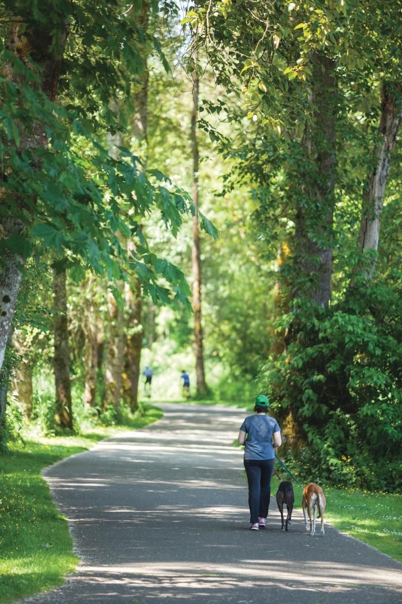 Amenities include community walking trails