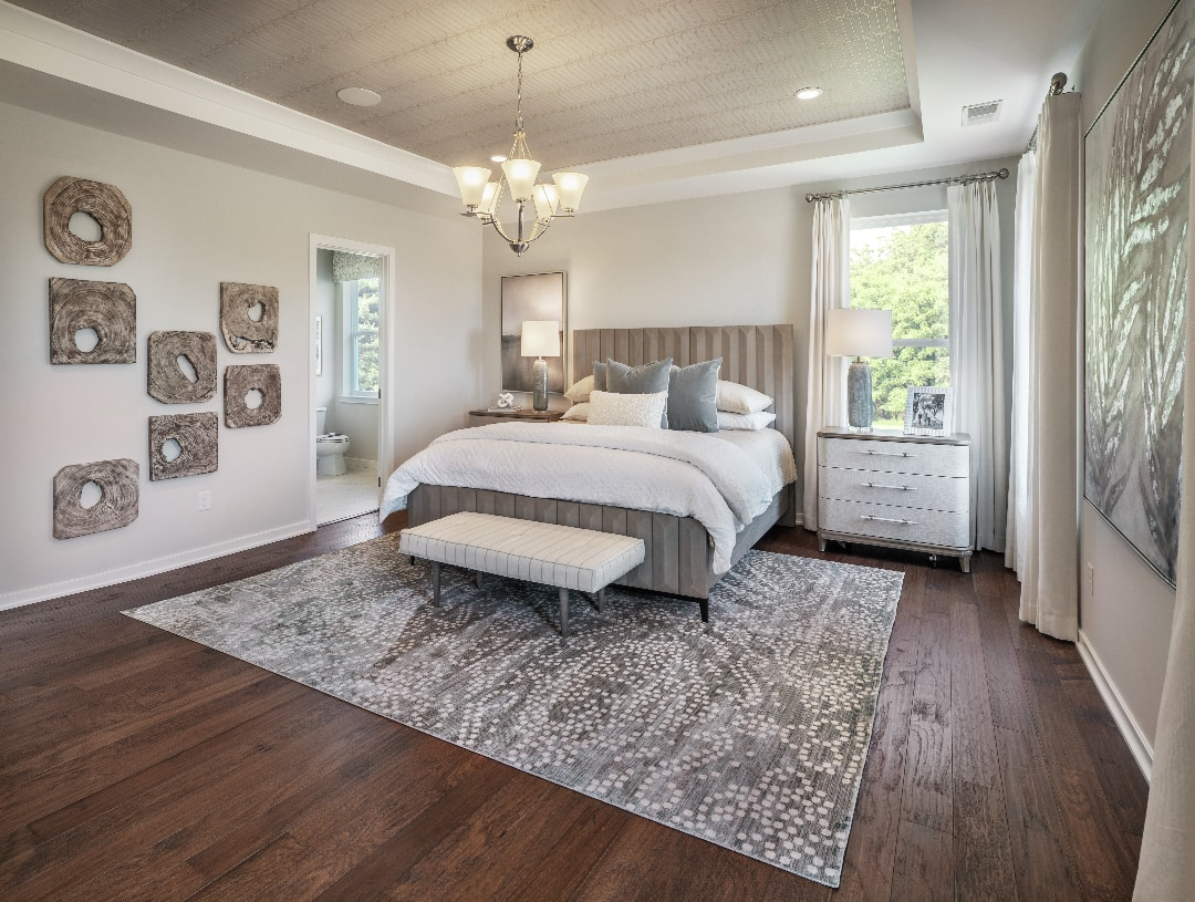 Primary bedroom suites with deluxe primary bath and walk-in closets