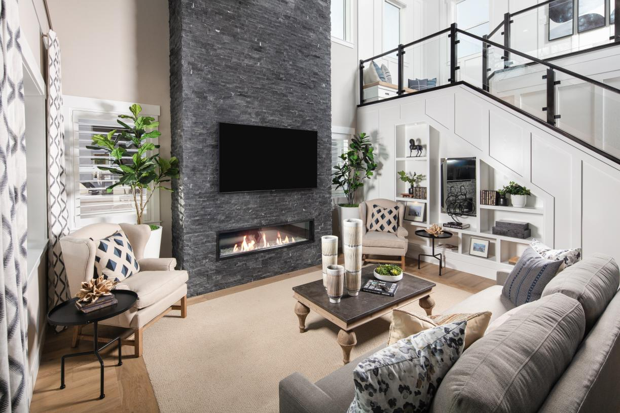 Modern great room with two-story fireplace