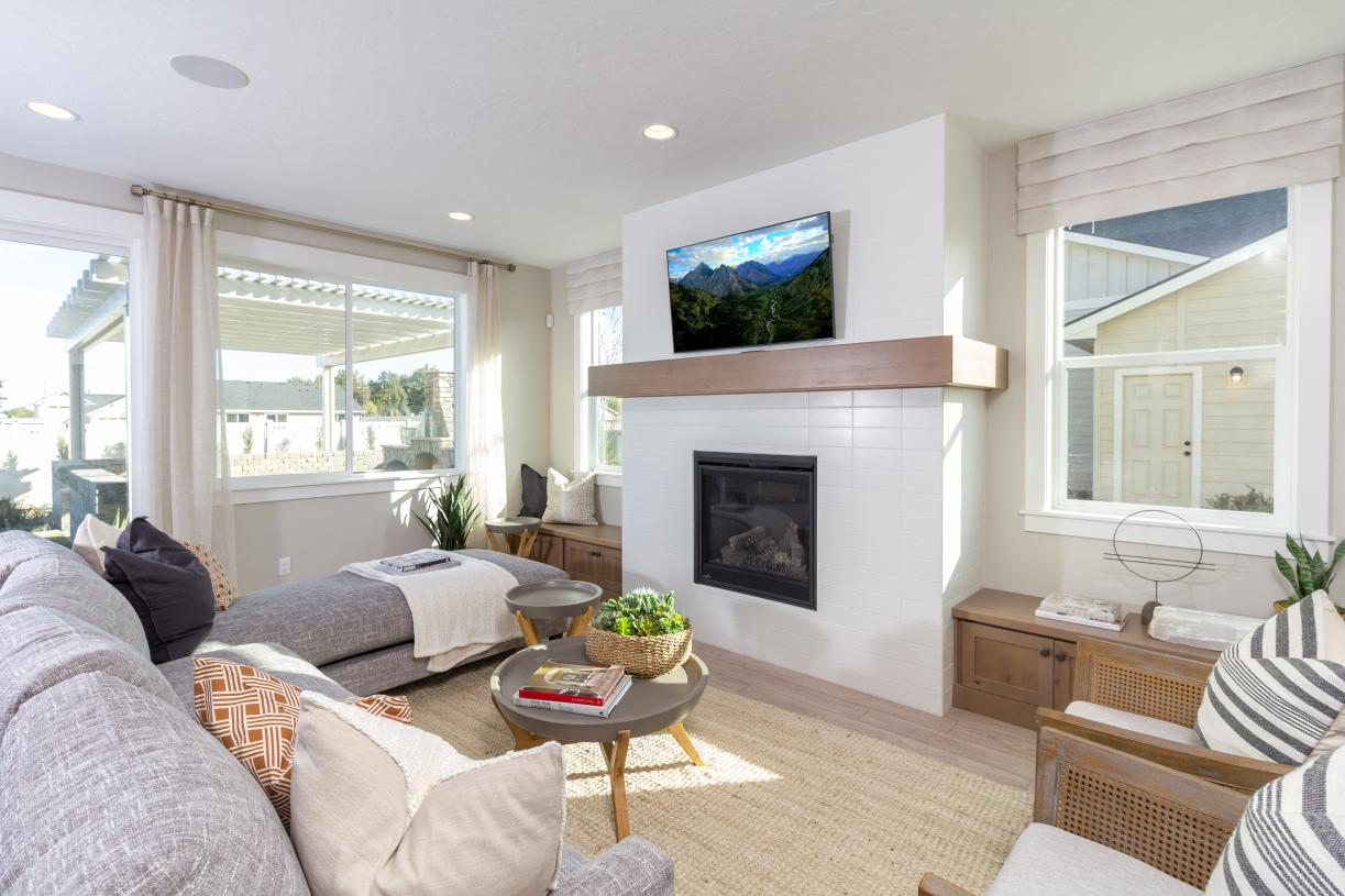 Great room with tiled gas fireplace and wood mantle