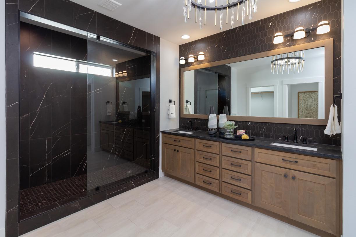 Luxury shower and dual-sink vanity in primary bathroom