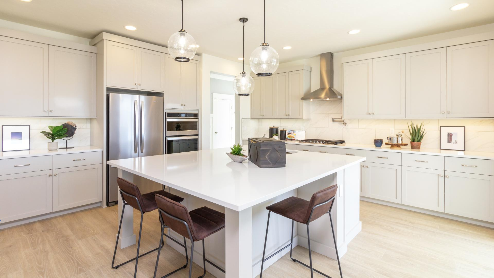 Spacious kitchen with dual oven, gas cooktop and pot filler for convenience