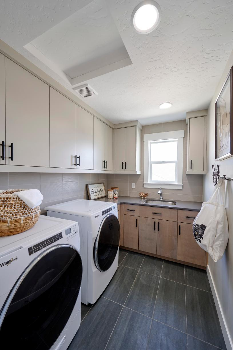 Convenient laundry room with sink and storage
