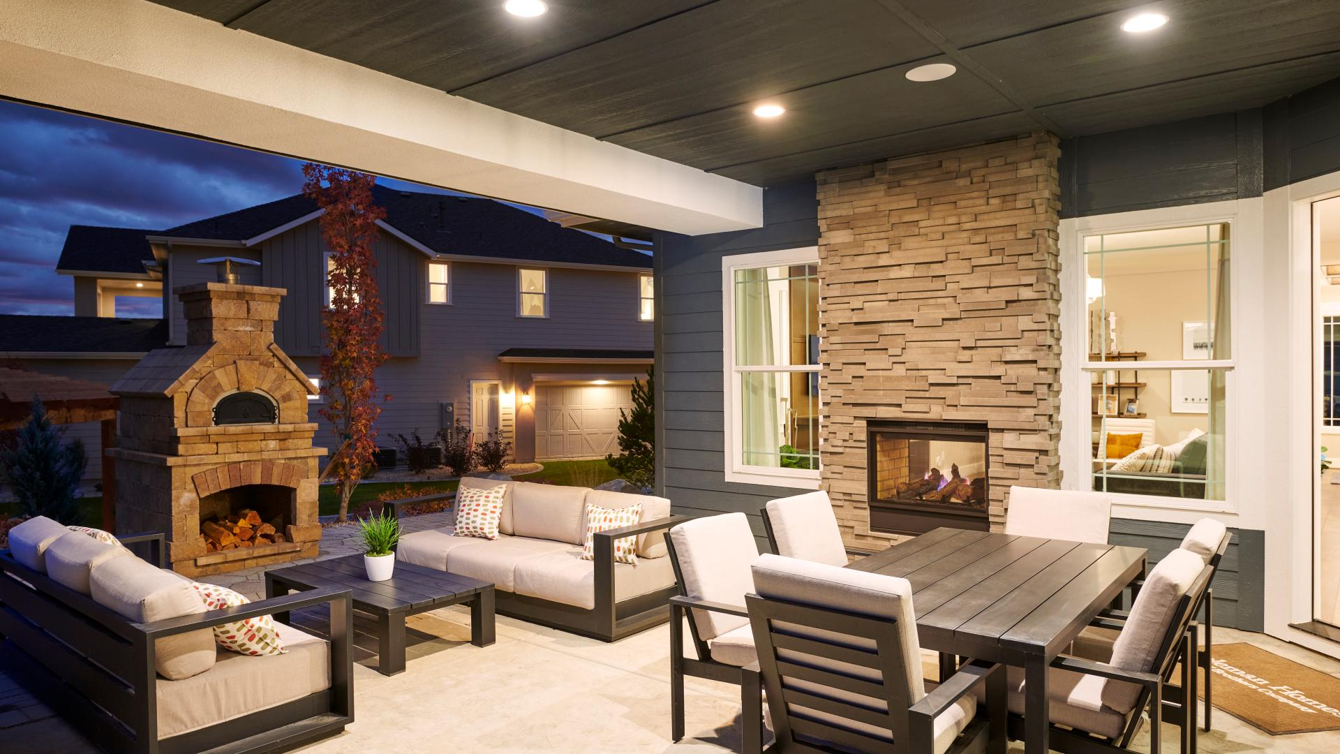 Sizable covered patio with dual-sided fireplace perfect for entertaining