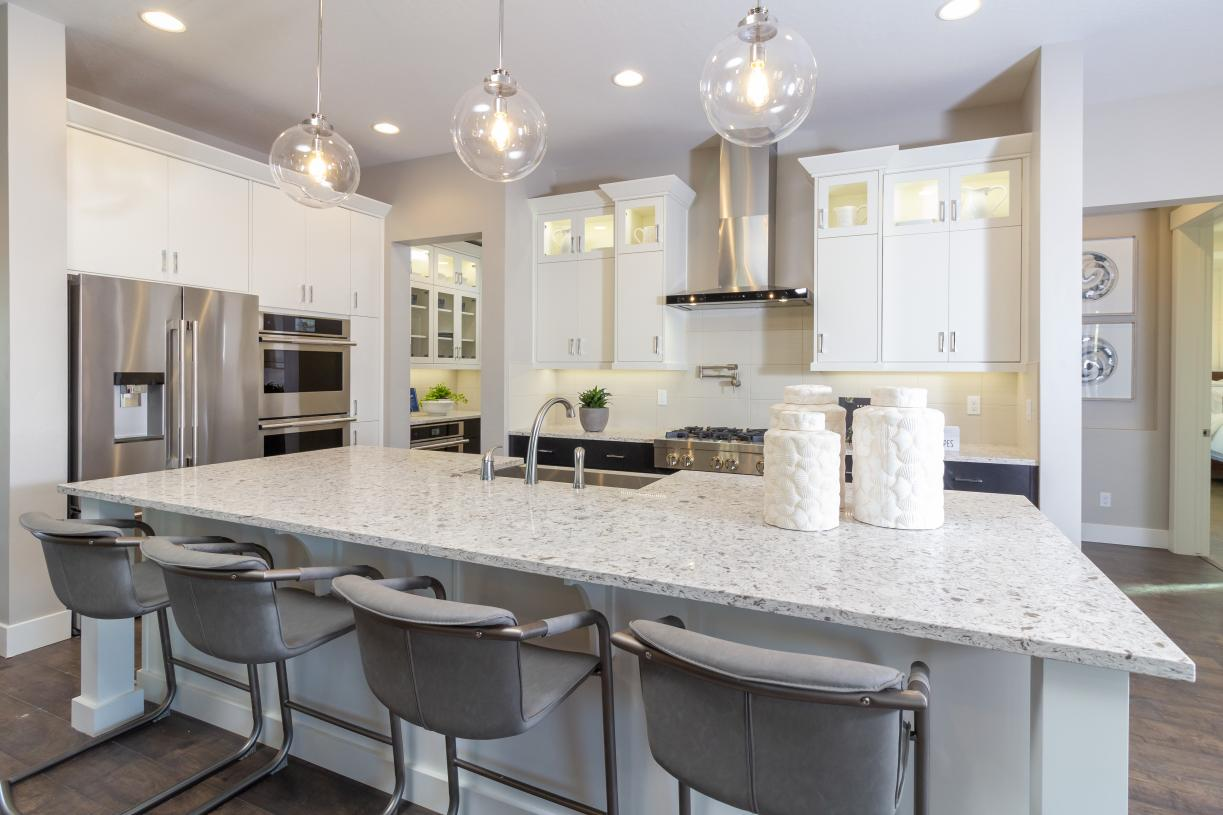 Enjoy convenience in this kitchen with dual oven, gas cooktop, pot-filler and ample counter space