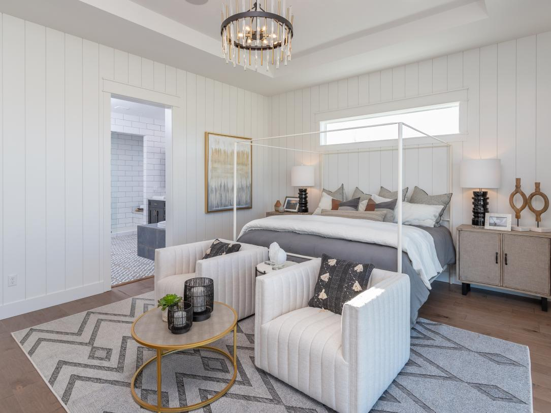 Spacious primary bedroom provides extra room for sitting area