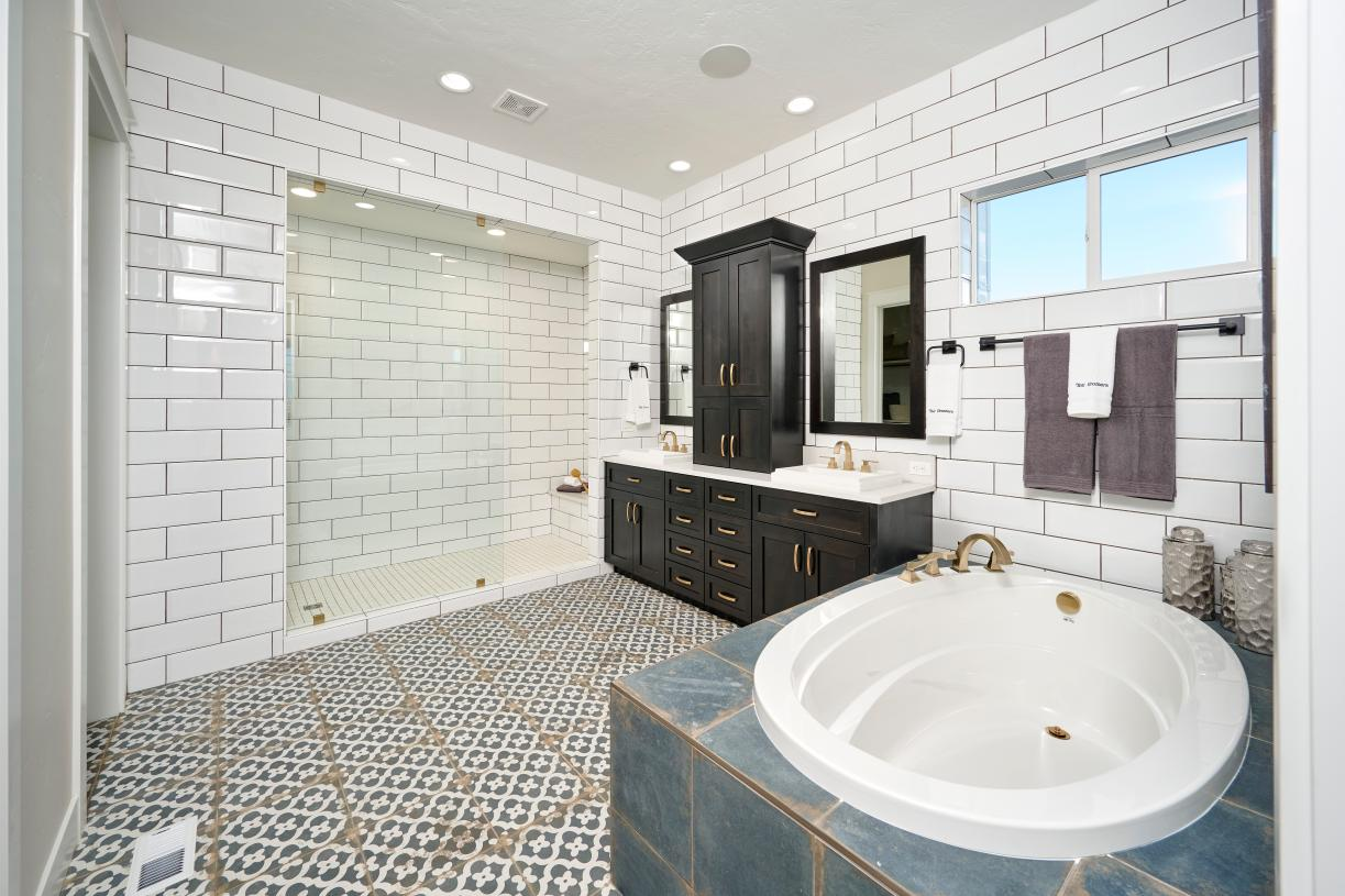 Spa-like primary bathroom with full tiled walk-in shower and separate soaker tub