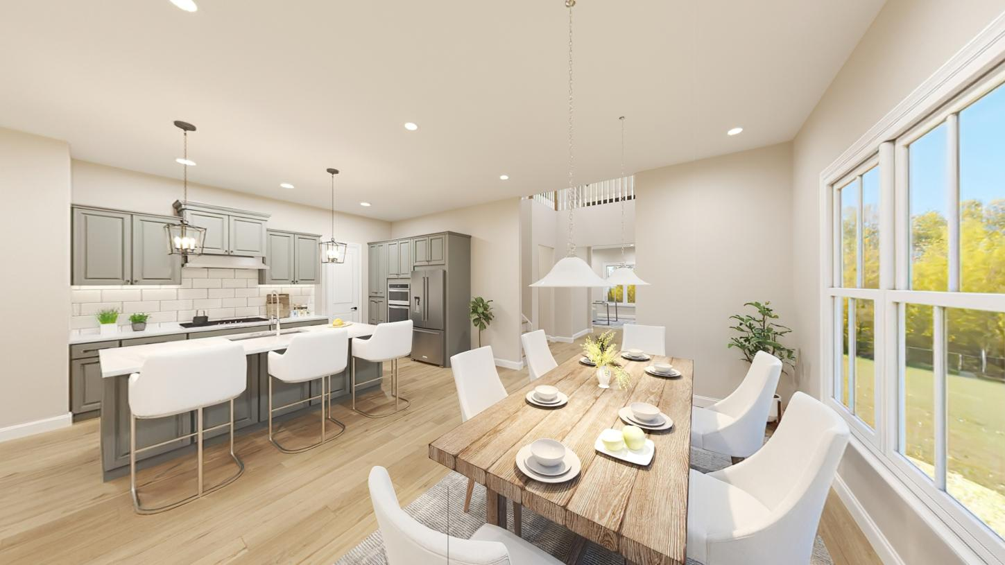 Open kitchen with large center island with casual dining area